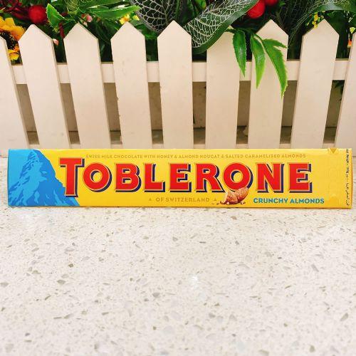 Toblerone瑞士三角牛奶巧克力盐�h松脆巴坦木100g